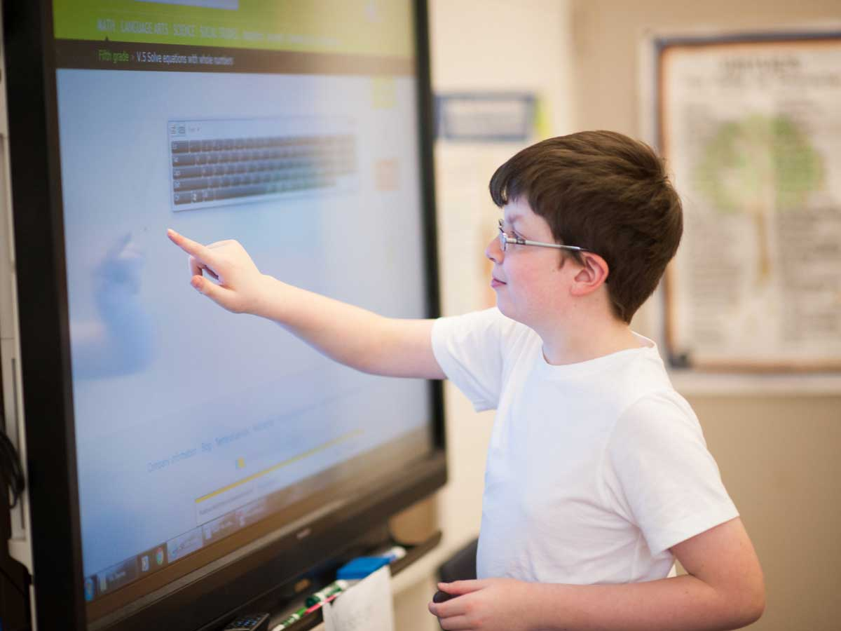The Diener School Middle School Math Program Student working on Smart Board